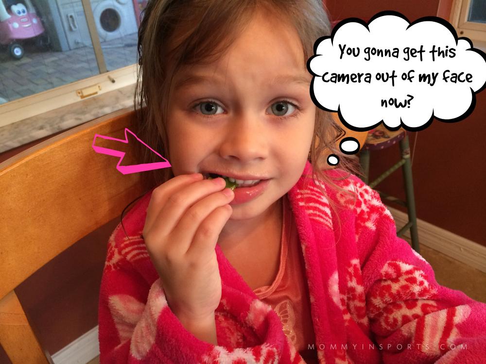 Lila Trying Snow Peas