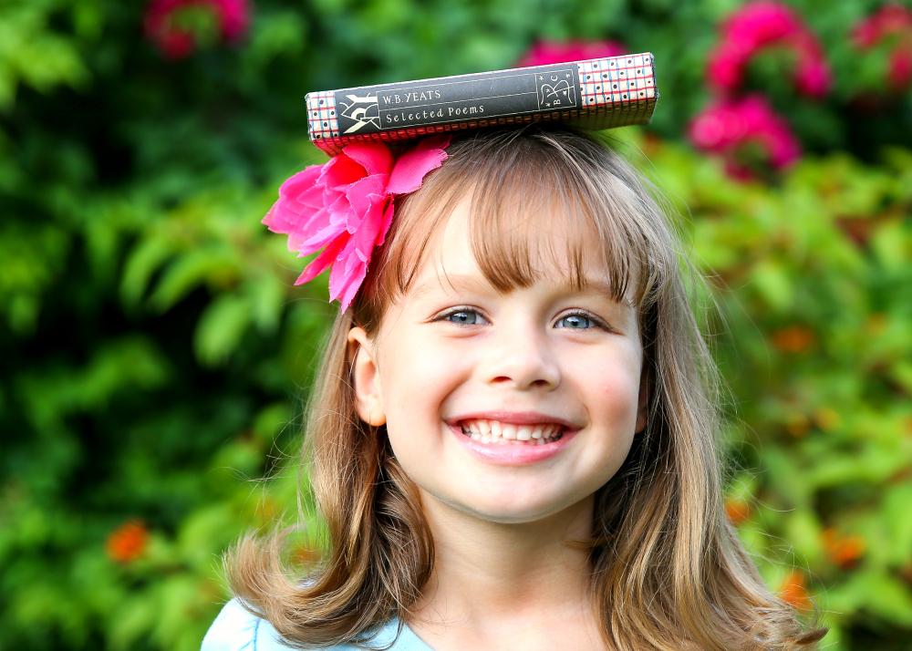 Lila Books on Head