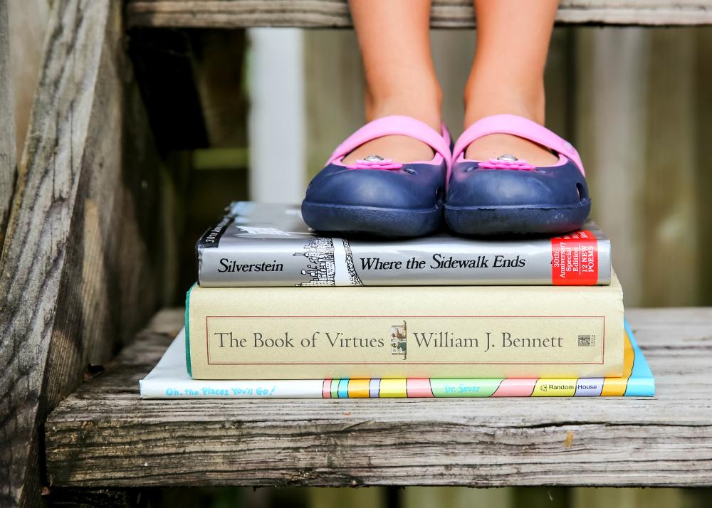 Lila feet on books
