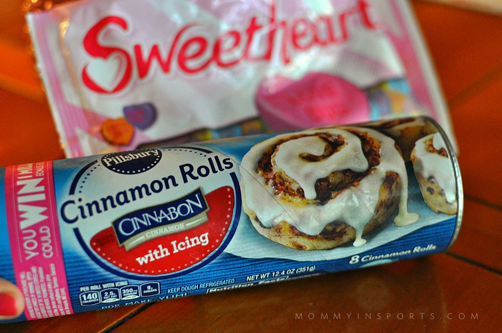 Need simple recipe to surprise your family, friends or coworkers on Valentine's Day? Why not make these super easy heart shaped Valentine's cinnamon rolls?!