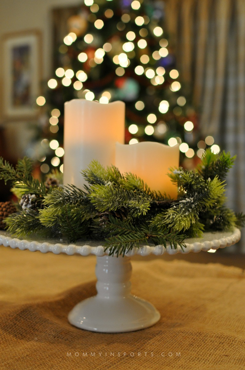 Use your cake plate to decorate! Add some greenery, pine cones and candles and you have a rustic chic DIY holiday centerpiece!