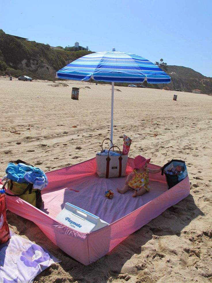 Top 5 Summer Saving Beach Hacks for Parents - use a fitted sheet to keep out sand!