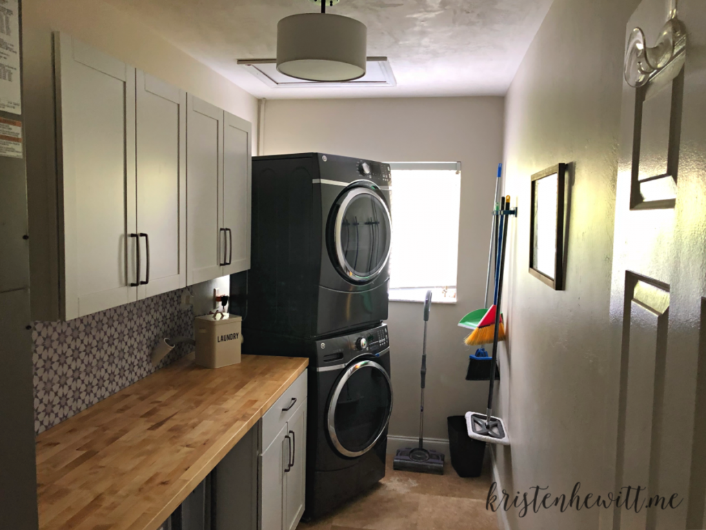 Looking for a simple and budget friendly way to reorganize your laundry room? Here's a DIY laundry room makeover you can do in a weekend!